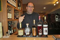 Greg Gilbert stands with part of his 700-bottle collection. Rye Bourbon, Bourbon Drinks, Greg Gilbert, Old Bottles, Whiskey, Barrel, Economics Articles, Cooking, Wall Street