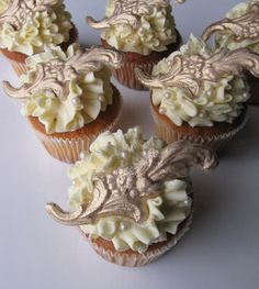 Gold Flourish cupcake with gold chocolate toppers