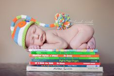 adorable newborn photo.  Dr Seuss books!