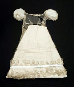 The silk overdress part of a wedding gown 1825-30. The dress is in cream silk satin. Fantastic hem! Snowshill Manor, National Trust