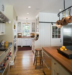I love the copper pans, the wood countertops, the cabinets and windows. And the sliding door for the pantry. Okay, I just like it all.