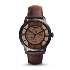 Townsman Automatic Leather Watch – Dark Brown The top-of-the-hour Townsman automatic takes its cues from vintage designs. Included with our up-to-the-minute innovation? A refined black case houses an amber crystal lens and a see-through skeleton dial.