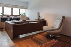 modern ceo office interior design - white walls, natural lighting, wood accents