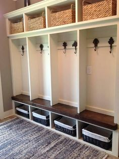 perfect for the we-don't-know-what-to-do-with-these shelves and bookcase = basement entry / mudroom.  just shuffle a few shelves around and paint it.