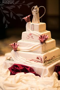 Anna and Spencer Photography , Atlanta Wedding Photography . Egyptian Wedding Cake with Cartouche and Pink Lotus Flower Design . Cake by Art's Bakery in Atlanta .