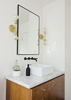 Bathroom Light Fixtures In Gold sleek bathroom design with glossy wooden vanity and square sink