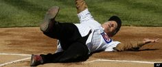 Bill Murray slides in to first at Wrigley Field.  Murray threw out the first pitch and sung the 7th inning stretch at the Cub's 2012 home opener