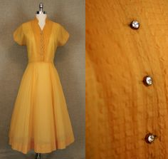 Vintage 1950s Dress / Golden Yellow Sheer Dress. $68.00, via Etsy.
