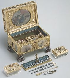 Nécessaire, Watchmaker: James Cox  (ca. 1723–1800)  Date: ca. 1770–72  Culture: English (London)  Medium: Case: moss agate, mounted in gold and set with diamonds, rubies, and emeralds; silver; Dial: white enamel, with frame pavé-set with paste jewels