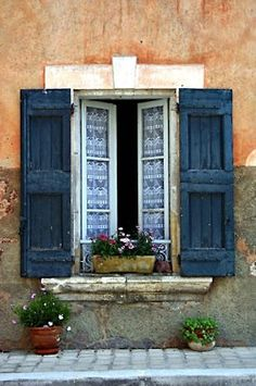 blue shutters and white lace curtains