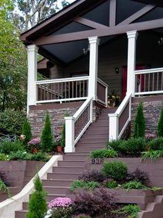 Front steps, white rails and banisters, black porch