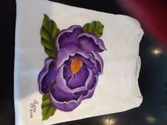 Fabric painting on the t-shirt with acrylic paints, decorated with little purple crystals.
