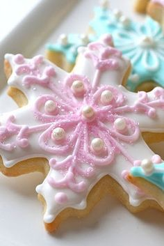 Pastel colored snowflake sugar cookies, what a treat!