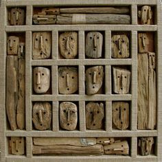 Marc Bourlier, Old wood faces  Uniformity but sence of difference too. Love how the case and the items are so close in colour and texture
