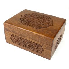 Handmade Carved Box - Rose Detail Design Handmade and Fair Trade. Featuring a rose design with paisley detail carved on five sides, this box with hinged lid is carved by Indian artisans. The box is 8 by 6 inches and 4 inches tall.