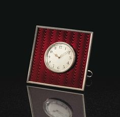 An Important Silver And Guilloché Enamel Presentation Clock Marked Fabergé, With The Workmaster's Mark Of Henrik Wigström, St. Petersburg, 1903-1904