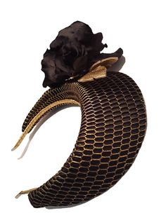 Black floral Crown Hand blocked crown headpiece has been covered with a black silk and black and gold window overlay. Handmade black silk roses adorn the right side with gold leather leaves. Secured with a gold covered headband. Height - 10cm Item is made to order, please