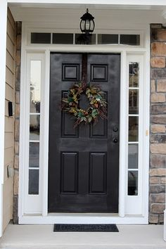 The trim/molding around this door is 'Swiss Coffee' by Behr. This color will be used for all of the crown, base, door, and window molding throughout our house as well as for the garage walls.