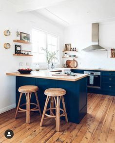 Small kitchen with wood countertops, dark blue cabinets, and floating wood shelves and modern stainless steel vent hood Kitchen Room Design, Modern Kitchen Design, Kitchen Layout, Living Room Kitchen, Home Decor Kitchen, Interior Design Kitchen, New Kitchen, Home Kitchens, Small Kitchen Diner