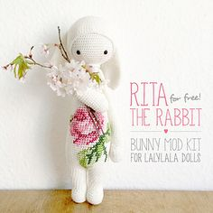This pattern is available for free. It is a modification of her other for sale doll patterns. There is a lovely cross stitch pattern, eggs and cute bunny ears.