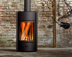We have warmed to many wood stoves, including the lovely modern Rais, but our jaw dropped when we saw the stunning Belgian Stûv at the Interior Design Show. However its inner beauty was revealed when we looked at its features and specifications. Interior Design Shows, Porch Entry, Fire Pit Backyard, Backyard Seating, Backyard Landscaping, Backyard Ideas, Wood Burner, Stove Fireplace, Sustainable Design