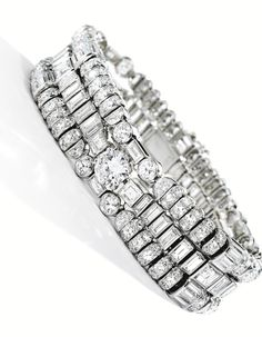 PLATINUM AND DIAMOND BRACELET, MARCHAK, PARIS Of highly flexible design, set with numerous variously-cut diamonds weighing approximately 26....