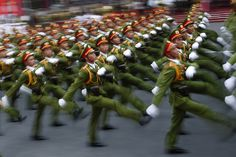 Military personnel take part in a parade celebrating the 40th anniversary of the end of the Vietnam war, also remembered as the 'Fall of Saigon', in Ho Chi Minh City. The city once known as Saigon was festooned in red banners that read 'Long Live the Glorious Party of Vietnam', 40 years after communist forces seized control of the country and America walked away from the divisive and bloody war