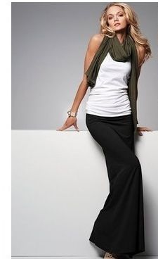 Great style with her black maxi skirt, white top and khaki scarf.