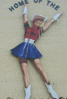 """The K Girl"" displayed on the side of the Rangerette Gym in Kilgore, Texas."