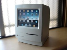 I love this idea of recycling a retro Apple computer into an iPad holder.