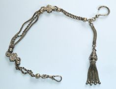 A VICTORIAN UNMARKED SILVER ALBERTINA WATCH CHAIN WITH TASSEL