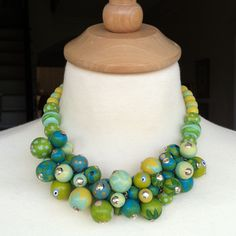 hand painted libby cluster necklace in shades of blue and green with sterling silver bead caps
