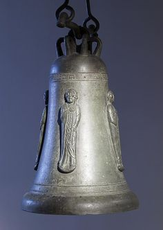 This bronze bell dated from medieval times, depicts Saints Peter, Paul, John the Evangelist, and Thomas.[11] The Walters Art Museum.