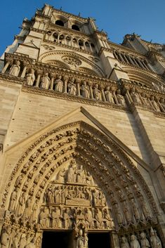 Dominating the lower third of the façade are three impressive arched portals with stone carvings and heavy wooden doors. Click here to find out more about Notre Dame! http://mikestravelguide.com/things-to-do-in-paris-visit-notre-dame-cathedral/
