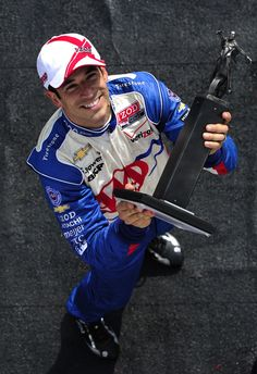 Helio Castroneves of Brazil driver of the #3 Team Penske Dallara Chevrolet on the podium after finishing in third place during the IndyCar Series Honda Indy Grand Prix of Alabama at Barber Motorsports Park on April 1, 2012 in Birmingham, Alabama.  (
