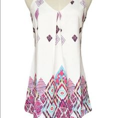 NWOT Cute Aztec-Patterned Dress Brand new white dress with vibrant Aztec pattern mainly on the bottom. Thin straps, v-neck style neckline. Very cute and never before worn. Size medium. No signs of wear, stains, or damages of any sort. Smoke-free home. Dresses Mini