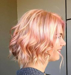 blonde wavy bob with pastel pink highlights