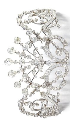 DIAMOND NECKLACE/TIARA, CIRCA 1910 Designed as interlocking garlands of floral and foliate decoration, millegrain-set with circular-, single-, rose-cut and pear-shaped diamonds, accompanied by a torsade chain to be worn as a necklace, tiara frame deficient, length approximately 470mm.