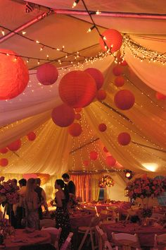 Emma Corrie Barbados Wedding Reception with Romantic White Lights under Silk Tent. paper lanterns in shades of pink and orange.