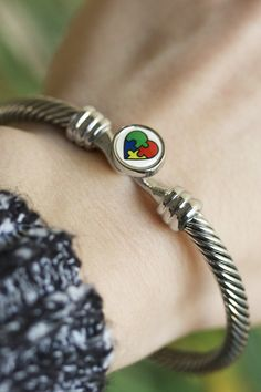 Get hooked on spreading awareness! Rope in your embrace of autism and lasso compliments with our striking silver-tone bracelet hitched by a hook and puzzle piece clasp.
