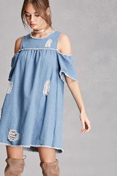 A denim babydoll dress featuring a distressed style, frayed short open-shoulder sleeves, a round frayed neckline, and a frayed hem. This is an independent brand and not a Forever 21 branded item.