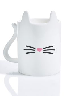 Purrfect Cuppa Mug will warm yer heart 'N soul, bb~ This adorable mug features a white base with kitty ears comin' off the rim, tail shaped handle, and minimal nose 'N whisker graphics across the front.