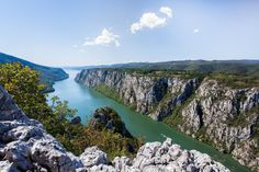 """Danube river .Danube gorge """"iron gate"""" on the Serbian-Romanian border .  The Djerdap Gorge is one of the largest gorges in Europe. It consists of four gorges and three ravines. The most beautiful gorges are ''Mali kazan'' and ''Veliki kazan', where the Danube narrows at only 140m and reaches the depth of 90m, so that the bottom under the sea level of The Black Sea is about 30m.  by Slavica Stajic on 500px"""
