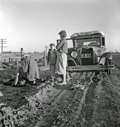 Migratory agricultural worker family along California highway. U.S. 99, March 1937 Dorothea Lange photo