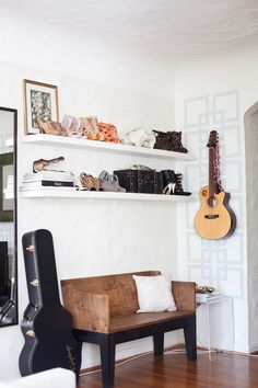where my guitar will inevitably land. hanging on the wall. hey, fyi learning to play the guitar is effing hard.