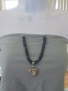 'Blue and Silver Necklace Watch' is going up for auction at  1pm Mon, Jun 17 with a starting bid of $12.