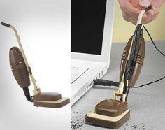 The mini desk vacuum is a small desk vacuum that is actually shaped like a stand up carpet vacuum. Why swipe the crumbs on your desk with your hand into the gargbage or onto the floor, when you can sp...