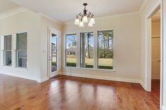 Breakfast nook off of the kitchen overlooks a brick patio and beautiful backyard.