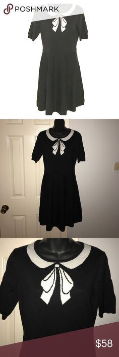 "CeCe black intarsia knit A-line bow dress Medium This knit dress feature a Peter Pan collar and bow. It is a fitted A-line cut from 💯 % cotton. Brand is CeCe. Short sleeves. Stretch knit. Size medium. Measures approximately 36.5"" in length. Great dress! From a smoke feee home. Bundle with other items in my closet to save even more. CeCe Dresses"