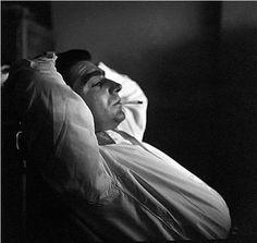 Photographer Robert Capa, Magnum Offices, Paris, 1949. Photo: Ernst Haas.